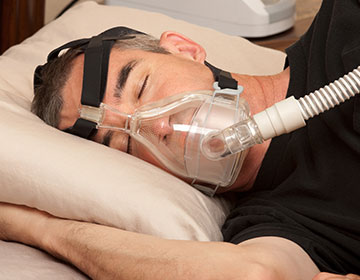 Man sleeping with a CPAP mask