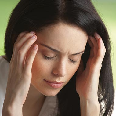 Woman holding head suffering from headache