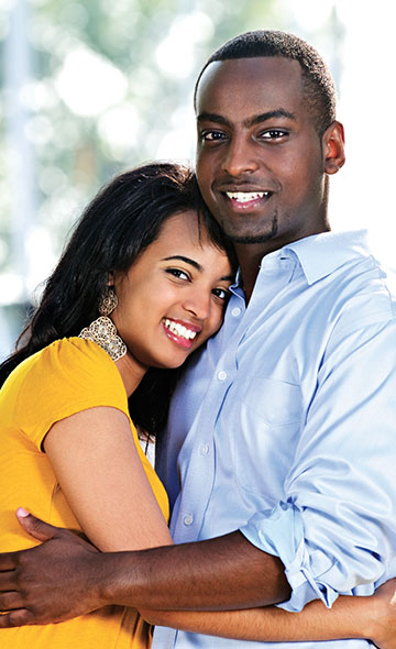 Couple embracing comfortably and smiling