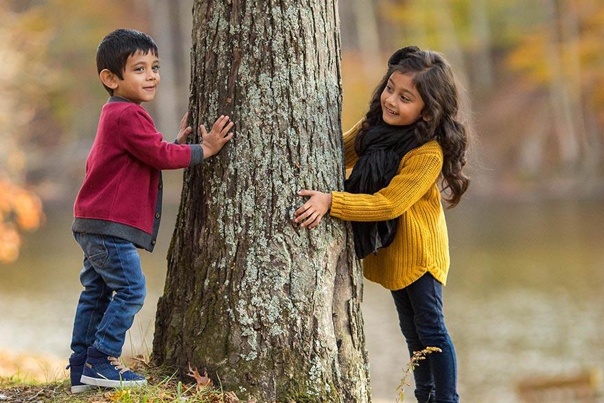 Kids having fun by a tree