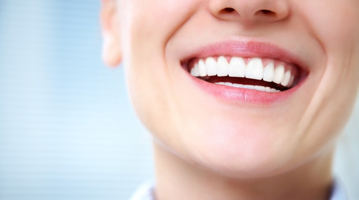 woman with healthy smile knows symptoms of gum disease