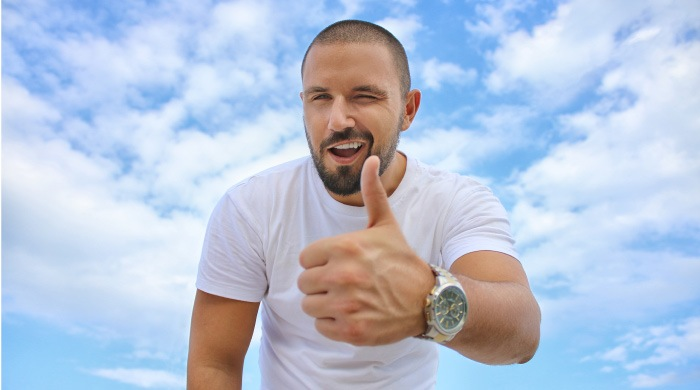 man giving a thumbs up to the durability of his CEREC dental crowns