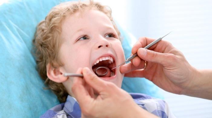young boy receiving a stress free dental exam