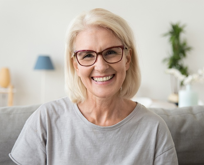 older lady smiling with glasses