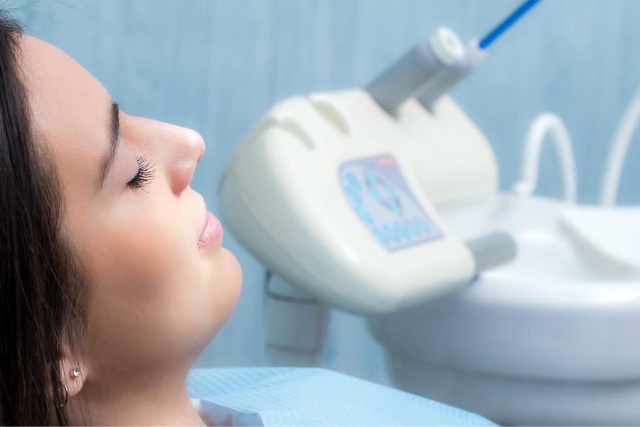 female dental patient undergoing dental sedation to alleviate dental anxiety