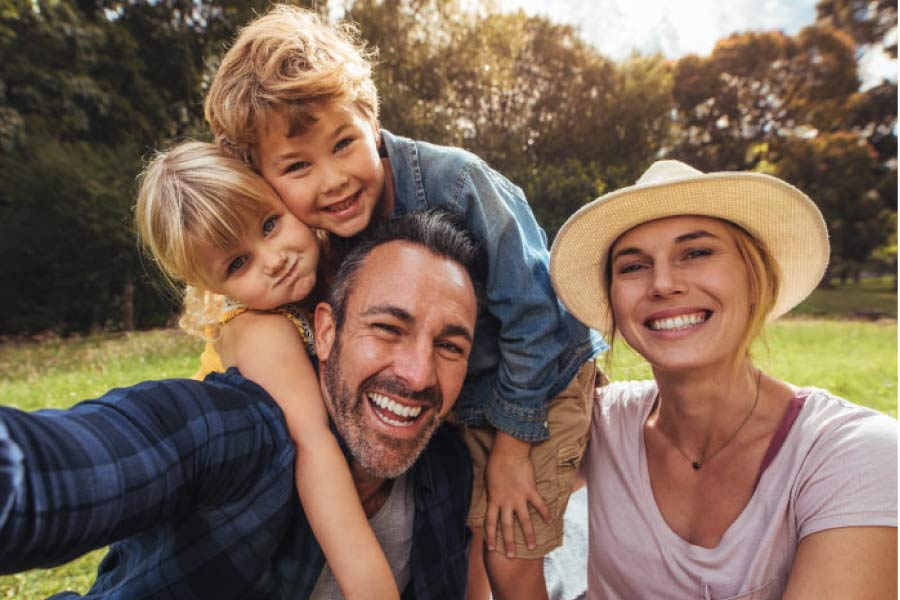family of four happy about affordable dentistry