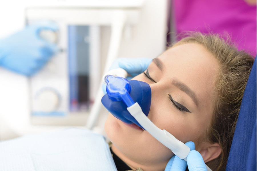 woman in the dentist's chair undergoing sedation dentistry to relieve anxiety