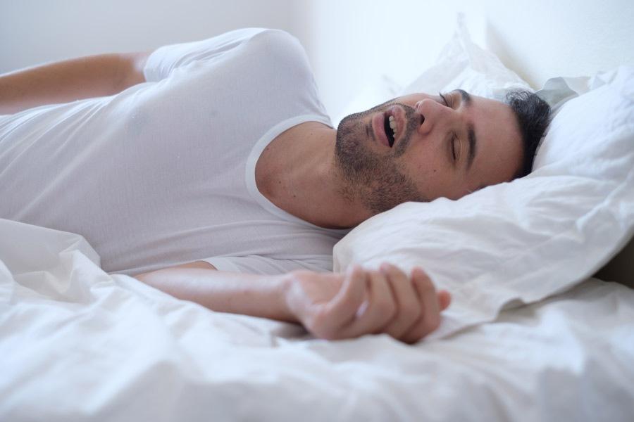 sleeping man grinding his teeth at night